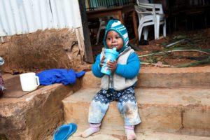Kind in einem Slum. (Quelle: Frank Rothe)